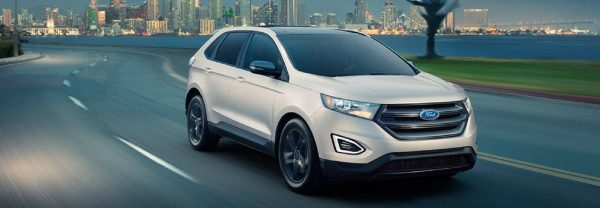 2018 Ford Edge driving down a road